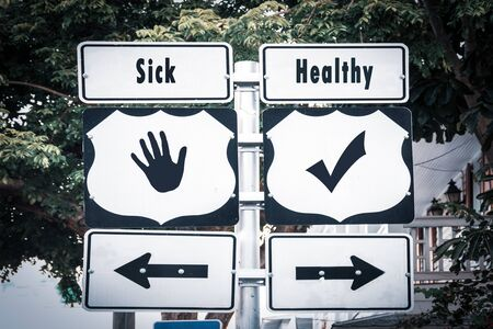Street Sign the Direction Way to Healthy versus Sick