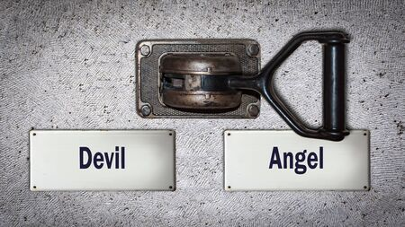 Street Sign the Direction Way to Angel versus Devil 스톡 콘텐츠 - 125625787