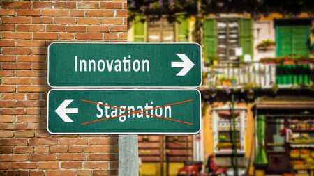 Street Sign the Direction Way to Innovation versus Stagnation