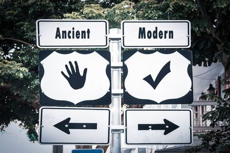 Street Sign the Direction Way to Modern versus Ancient Stock Photo