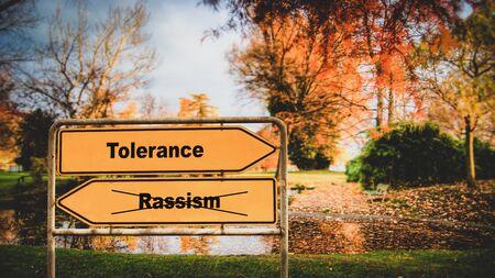 Street Sign the Direction Way to Tolerance versus Rassism Imagens