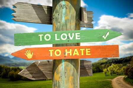 Street Sign the Direction Way TO LOVE versus TO HATE