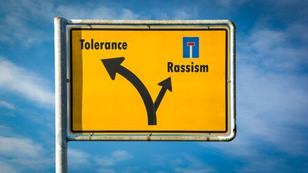 Street Sign the Direction Way to Tolerance versus Rassism Banco de Imagens