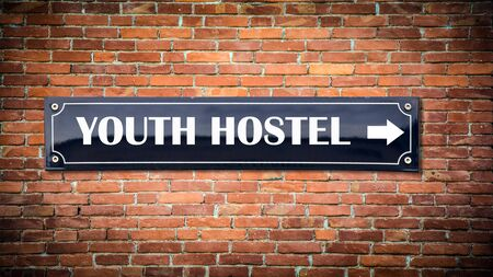 Street Sign the Direction Way to Youth Hostel Stock Photo