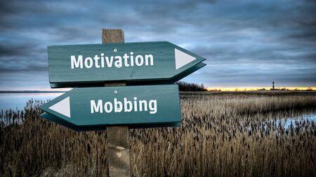 Street Sign the Direction Way to Motivation versus Mobbing Standard-Bild