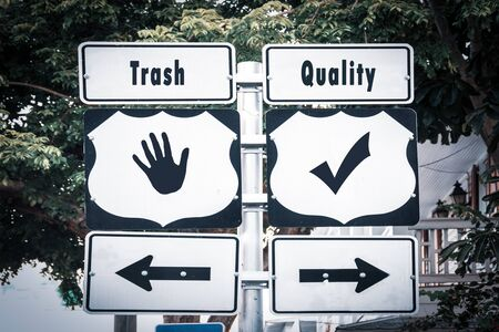 Street Sign the Direction Way to Quality versus Trash