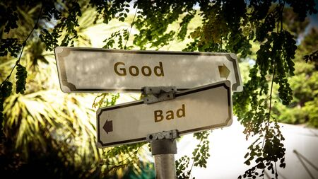 Street Sign the Direction Way to Good versus Bad 스톡 콘텐츠