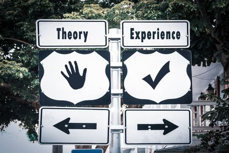 Street Sign the Direction Way to Experience versus Theory Stockfoto