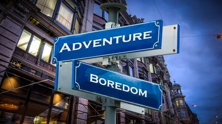 Street Sign the Direction Way to Adventure versus Boredom Stock Photo