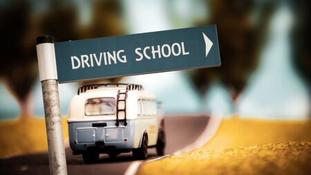 Street Sign the Direction Way to DRIVING SCHOOL Stock Photo