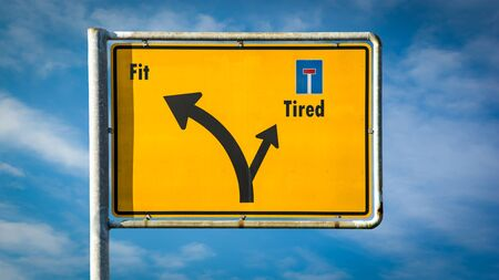 Street Sign the Direction Way to Fit versus Tired Stock Photo