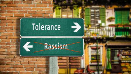 Street Sign the Direction Way to Tolerance versus Rassism Stok Fotoğraf