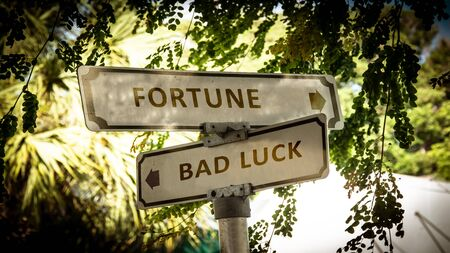 Street Sign the Direction Way to Fortune versus Bad Luck Zdjęcie Seryjne