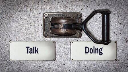 Wall Switch the Direction Way to Doing versus Talk Stockfoto