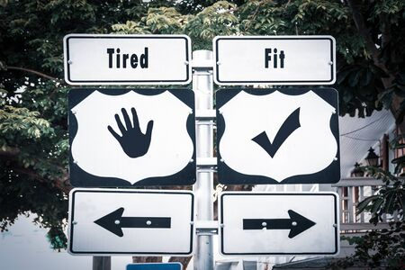 Street Sign the Direction Way to Fit versus Tired 스톡 콘텐츠