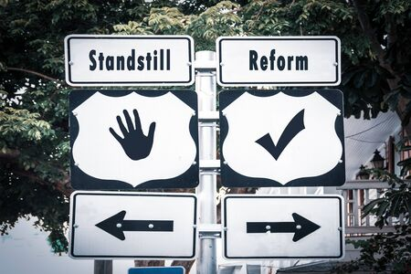 Street Sign the Direction Way to Reform versus Standstill