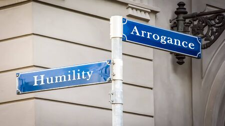 Street Sign the Direction Way to Humility versus Arrogance Фото со стока