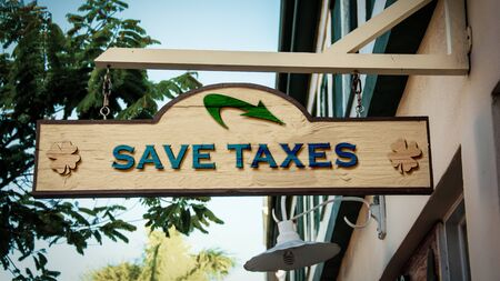 Street Sign the Direction Way to Save Taxes Banque d'images - 129171555