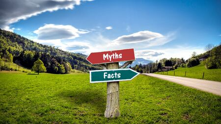 Street Sign the Direction Way to Facts versus Myths Foto de archivo - 129479214