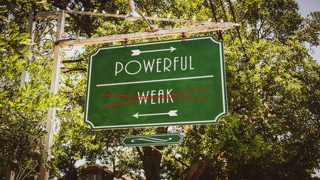 Street Sign the Direction Way to Powerful versus Weak 写真素材