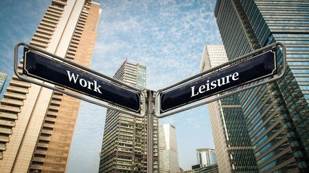 Street Sign the Direction Way to Leisure versus Work Stock Photo