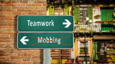 Street Sign the Direction Way to Teamwork versus Mobbing