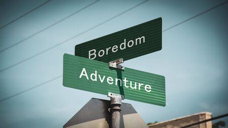 Street Sign the Direction Way to Adventure versus Boredom Standard-Bild