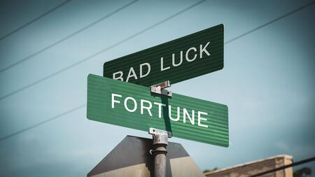 Street Sign the Direction Way to Fortune versus Bad Luck Фото со стока