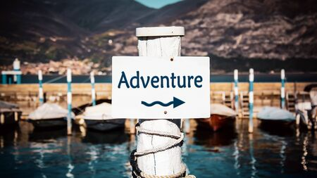 Street Sign the Direction Way to to Adventure Banco de Imagens