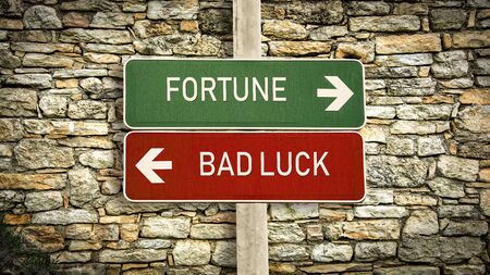 Street Sign the Direction Way to Fortune versus Bad Luck Reklamní fotografie