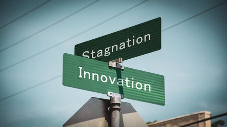 Street Sign the Direction Way to Innovation versus Stagnation Banco de Imagens