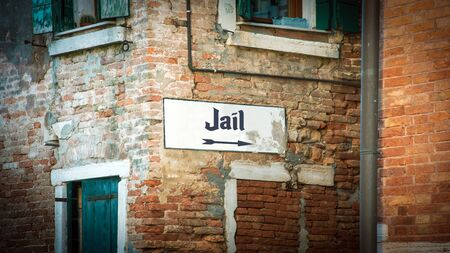 Street Sign the Direction Way to Jail Banco de Imagens