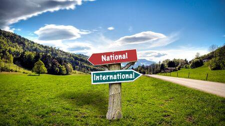 Street Sign the DIrection Way to International versus National Banco de Imagens