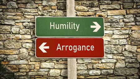Street Sign the Direction Way to Humility versus Arrogance 写真素材