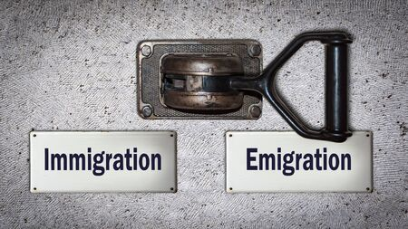 Wall Switch the Direction Way to Emigration versus Immigration 写真素材