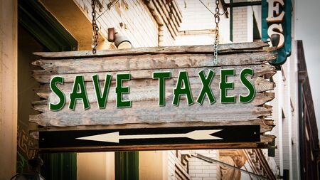 Street Sign the Direction Way to Save Taxes Imagens