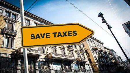 Street Sign the Direction Way to Save Taxes Фото со стока