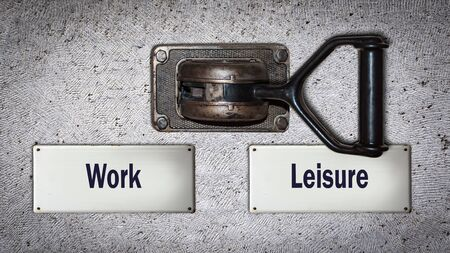 Wall Switch the Direction Way to Leisure versus Work Stockfoto
