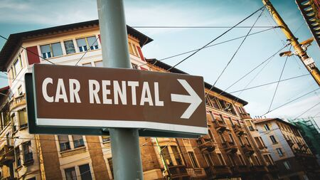 Street Sign the Direction Way to Car Rental Imagens