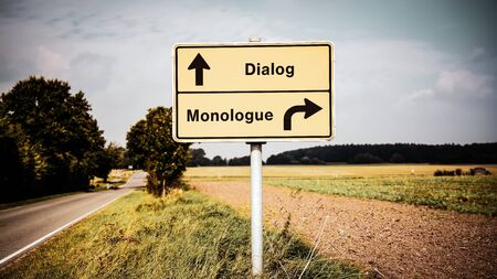 Street Sign the Direction Way to Dialog versus Monologue Stock Photo