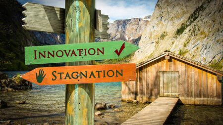 Street Sign the Direction Way to Innovation versus Stagnation Foto de archivo