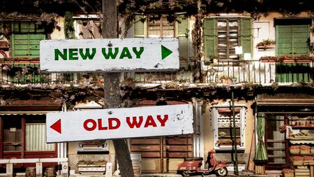 Street Sign the Direction Wy to NEW WAY versus OLD WAY Фото со стока