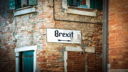 Street Sign the Direction Way to Brexit Фото со стока