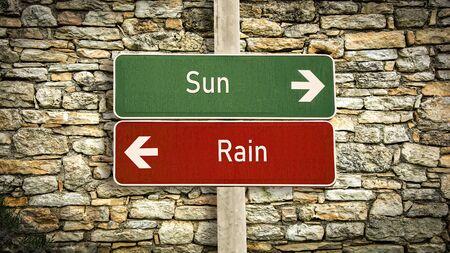 Street Sign the Direction Way to Sun versus Rain Standard-Bild - 133693004