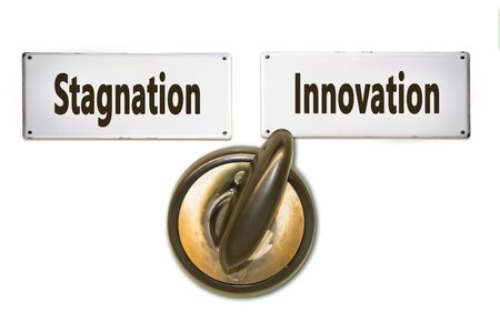 Street Sign the Direction Way to Innovation versus Stagnation Stock Photo