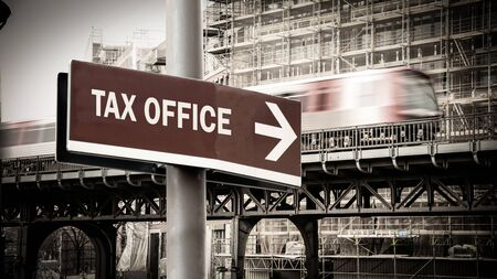 Street Sign the Direction Way to Tax Office