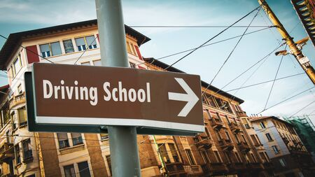 Street Sign the Direction Way to DRIVING SCHOOL Stock fotó
