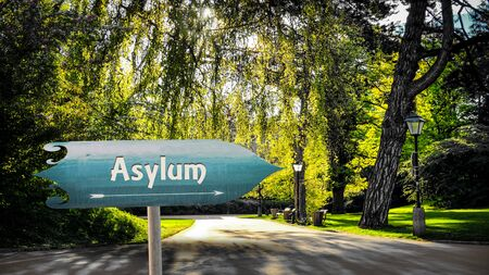 Street Sign the Direction Way to Asylum Stok Fotoğraf