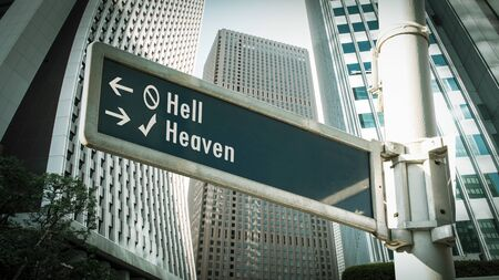 Street Sign the Direction Way to Heaven versus Hell Stok Fotoğraf