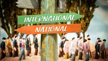 Street Sign the DIrection Way to International versus National Reklamní fotografie